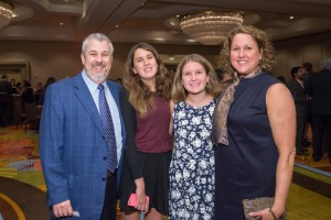 President Daniel Martell, and daughters Katie and Sarah, and wife Christine enjoy the festivities.