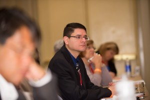 An attendee pays close attention to the discussion during the session.