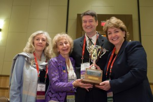 (L to r): Carol Henderson (Co-Chair), Carla Noziglia (Co-Chair), Matt Wood (Plenary Session Co-Chair), and Laura Liptai (Chair) prepare to award the first ever Academy Cup.