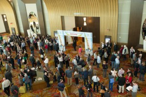 Attendees anxiously await the opening of the Exhibit Hall. Exhibitors prepare for the opening of the Exhibit Hall.
