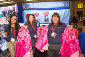 CRAIC Technologies team members prepare for the Exhibit Hall to open.