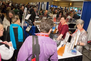 Exhibit Hall attendees take a moment to view the booths.