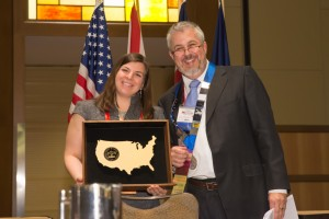 President Daniel Martell presents the Southeastern Association of Forensic Document Examiners Award to Kate Butler.