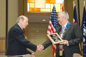President Dan Martell thanks John Young for his service on the AAFS Board of Directors.