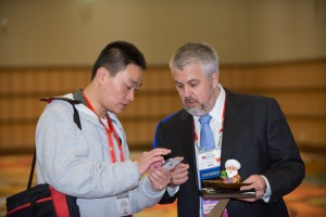 President Daniel Martell and an attendee look at the AAFS Guidebook App.