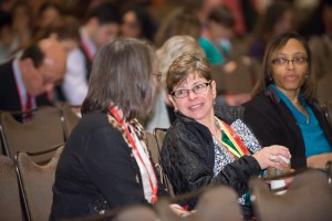 Attendees chat during a break in the Plenary Session.