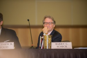 Panel member Barry Scheck listens to the discussion during the Plenary Session.