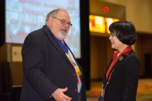 IAFS Past Presidents Barry Fisher and Heesun Chung talk after the Annual Business Meeting in Orlando.