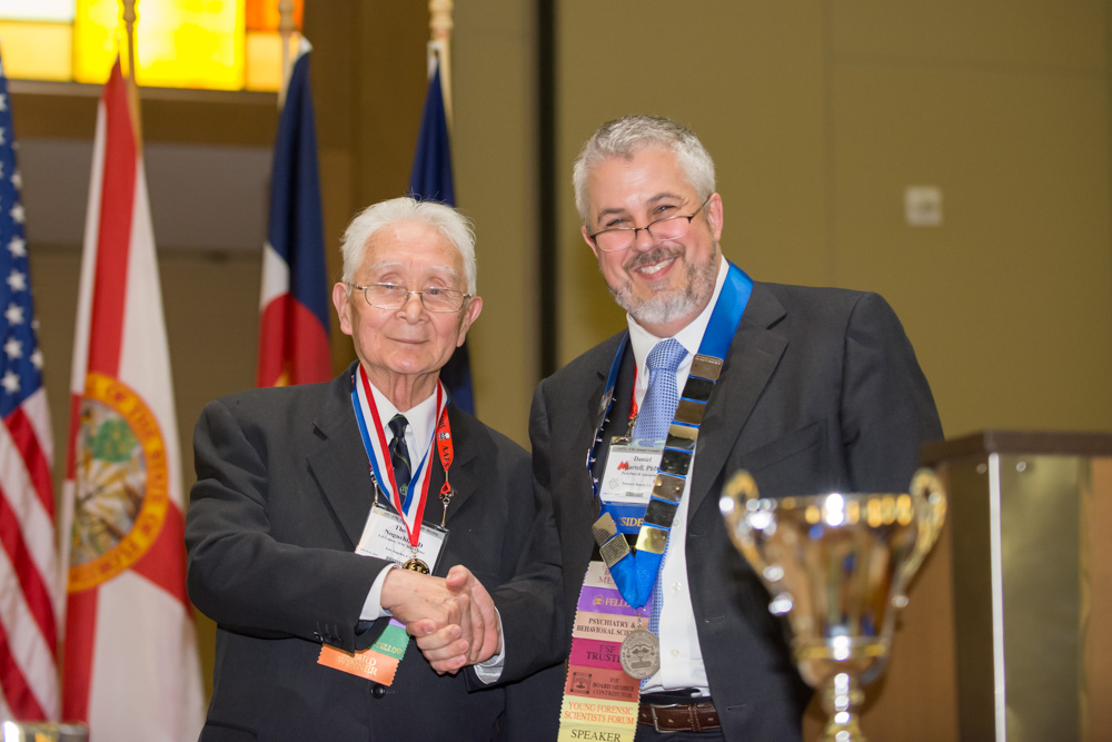 President Martell (r) honors Thomas Noguchi (l) with the AAFS Gradwohl Laureate Medallion during the 2015 Annual Business Meeting