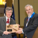 Victor Weedn accepts the President's Gavel Plaque from President Daniel Martell.