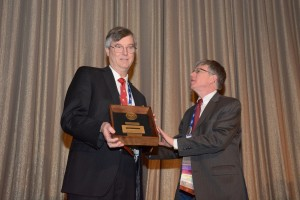 Douglas H. Ubelaker, PhD receives the Distinguished Fellow Award from President Victor Weedn during the  2016 Annual Business Meeting.