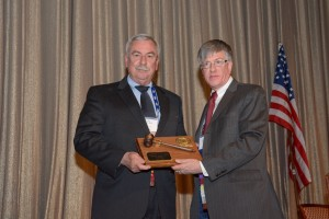 John Gerns accepts the President's Gavel Plaque from President Victor Weedn during the 2016 Annual Business Meeting.