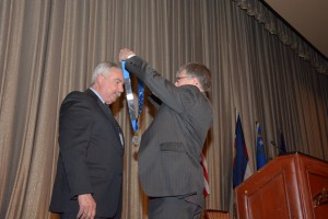 John Gerns accepts the President's Chain of Office from President Victor Weedn.